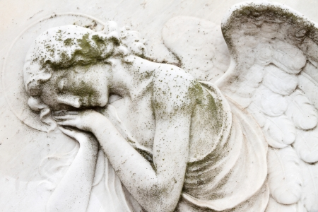 monumental cemetery: angelic image on tomb on monumental cemetery San Michele in Venice Stock Photo