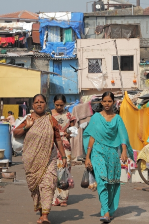 resulted: MUMBAI, INDIA-NOV 27  Women in district of slums on Nov  27,2010 in Mumbai Growth in urban population has resulted in a large section of  population living in abject poverty in overcrowded slums  Editorial