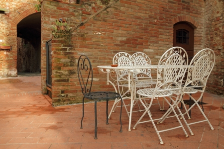 decorative vintage metal garden furniture on tuscan backyard, Certaldo  photo