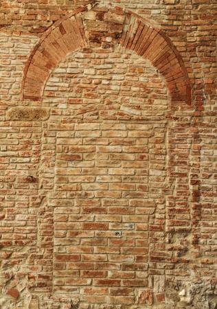 patrimony: antique brick wall with arch pattern, Certaldo