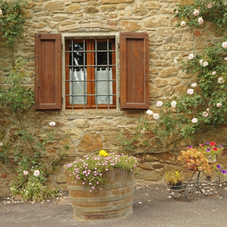 idyllic window with roses,borgo Volpaia, Tuscany, Italy  photo