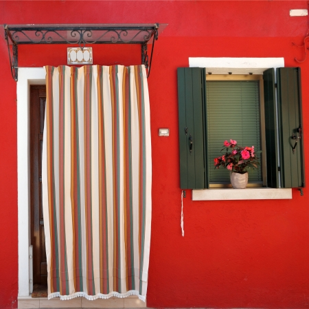 colorful front door to the house on the Burano island, Venezia, Veneto, Italy, Europe photo