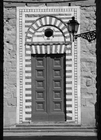ornamental  old  doorway to the Santo Stefano al Ponte church in Florence  photo