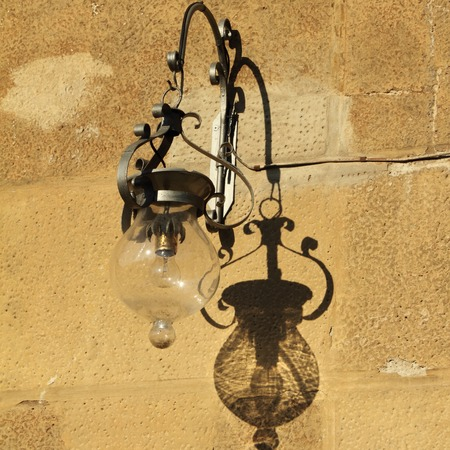 beautiful  old fashion lamp on wall in Florence, Tuscany, Italy, Europe  photo