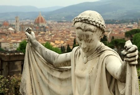 sante: sculpture  on  cemetery Porte Sante with view of Florence  Stock Photo