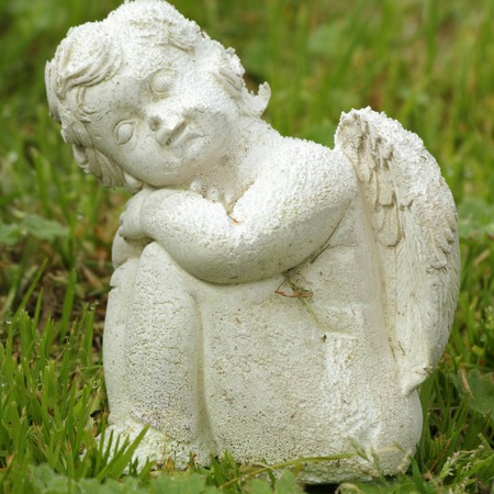 gypsum: figurine of small angel sitting on lawn