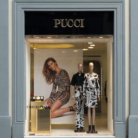 synonymous: FLORENCE - March 21  Emilio Pucci boutique in Florence on; luxury Tornabuoni street on March; 21; 2014  Emilio Pucci; and his; company are synonymous with geometric prints in a kaleidoscope of colors  Editorial