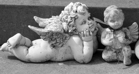 angelic figurines on tomb
