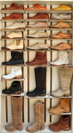 foot gear: display with fine leather shoes on italian market, San Lorenzo in Florence, Italy
