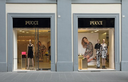 synonymous: FLORENCE - March 21  Emilio Pucci boutique in Florence on luxury Tornabuoni street on March, 21,2014  Emilio Pucci and his company are synonymous with geometric prints in a kaleidoscope of colors