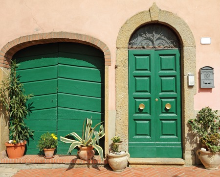 doors decorated with flowers in tuscan village Montescudaio photo & Abstract Doorways Set To The Tuscan Houses Italy Europe Stock ...
