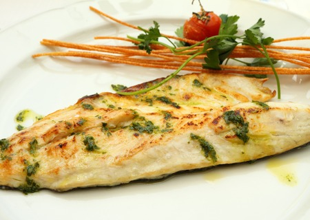 sea bass: Grilled sea bass Fish Fillet plate ,serving in italian restaurant