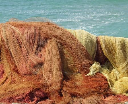 colorful fishing nets in sun on sea coast, Italy