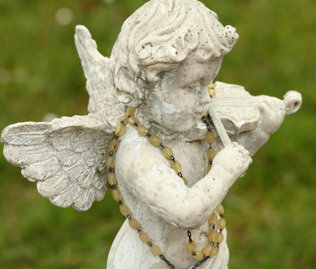 playing music: statue of little angel playing violin  Stock Photo