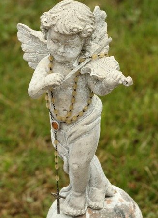 angel figurine: statue of little angel playing violin  Stock Photo
