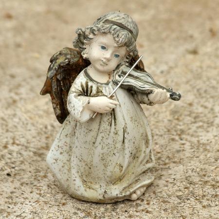 little angel figurine  playing violin photo