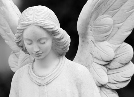 close up of winged angel statue