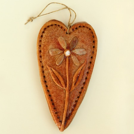 ginger bread heart  decorated with flower for hanging  photo