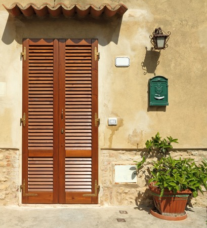 tuscan house: blinded door to the tuscan house, Italy