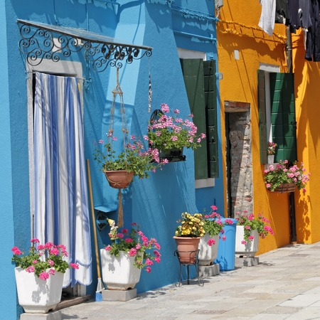 vase plaster: vivid painted houses in Burano village, Venice, Italy, Europe Stock Photo