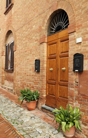 picturesque italian doorway in tuscan borgo Certaldo Alto photo
