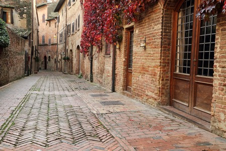 picturesque quiet brick alley in small town Certaldo Alto, Tuscany, Italy