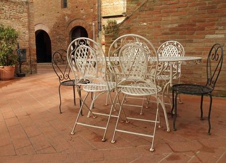 vintage iron  garden furniture on tuscan patio, Certaldo , Italy  photo