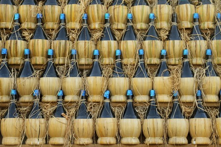 chianti: arranged many  chianti bottles in traditional pyramid on cart  , Florence, Tuscany, Italy