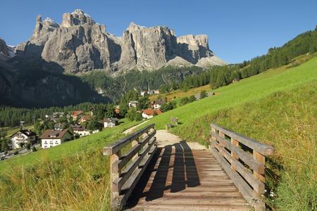 sella: landscape with village Colfosco and Sella peak, South Tyrol, Dolomites, Italy
