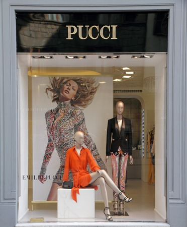 synonymous: FLORENCE - September 17: Emilio Pucci boutique in Florence on luxury Tornabuoni street on Sept. 17,2014. Emilio Pucci and his company are synonymous with geometric prints in a kaleidoscope of colors. Editorial