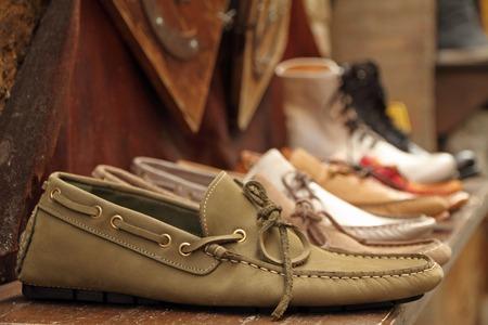 craftsmanship: moccasins style shoes on shelf by italian shoe maker, Italy
