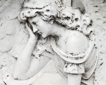 bas: angelic image relief on gravestone,Italy