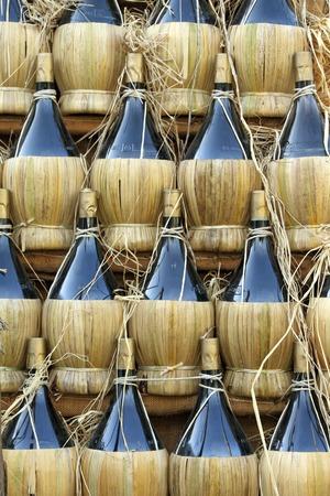fiasco: traditional tuscan wine bottles arranged in pyramid ( called fiasco ), Chianti region, Italy, Europe Stock Photo