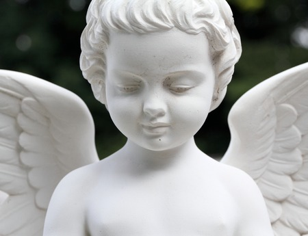 wistfulness: detail of beautiful cemetery angel statue