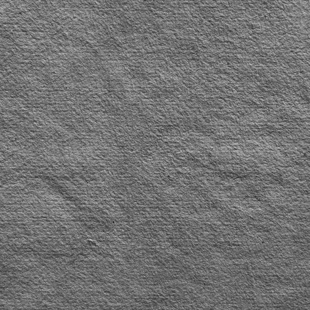 ashy: grey textured handmade paper as background