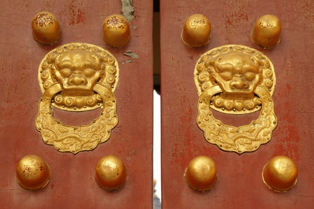 stud: closeup of chinese beautiful old door with lion knockers and studs Stock Photo