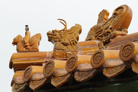 Imperial roof decoration of a minor building ,At the head of the procession  a man riding a Phoenix and the imperial dragon,Summer Palace in Beijing, China, Asia