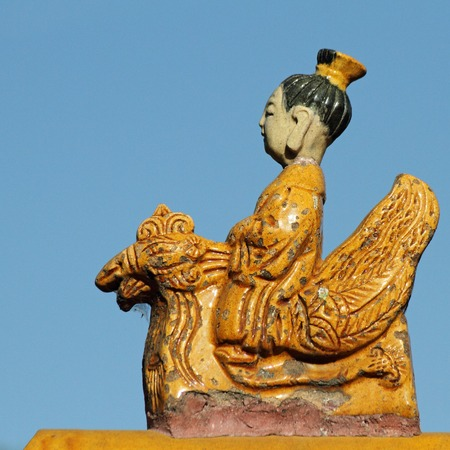 summer palace: beautiful ceramic figurine from traditional chinese roof decoration -  man riding a Phoenix, Summer Palace in Beijing, China, Asia