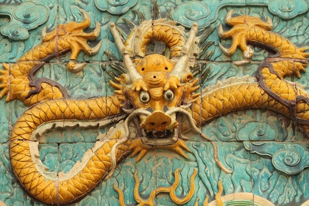 dragon decoration - in glazed ceramic - on wall in Forbidden City in Beijing, China, Asia