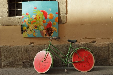 parked bicycles: funny bike on florentine street, Italy