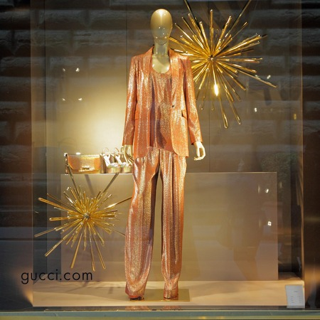 FLORENCE, ITALY - DEC 5: Gucci boutique in Florence on famous for luxury shopping Tornabuoni street on December, 5, 2013. Gucci was founded by Guccio Gucci in Florence in 1921. Editorial