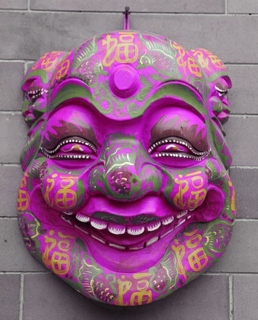 chinese opera: chinese mask on wall on Liulichang street in Beijing, China Stock Photo