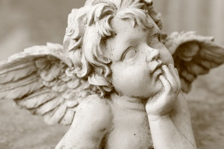 image  of cherub figurine in sepia
