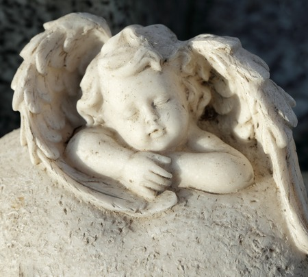 angel of death: sleeping little angel figurine - cemetery tombstone -detail
