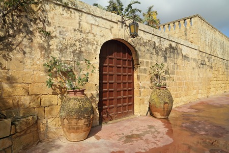 watered: elegant entrance to the old maltese villa, Malta