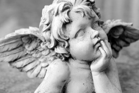 closeup of cherub figurine in black and white , Italy