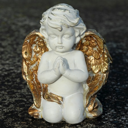 praying angelic little figurine