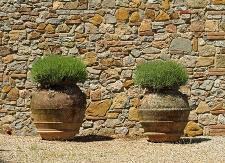 gravel: classic tuscan huge  terracotta flower pots, Tuscany, Italy, Europe