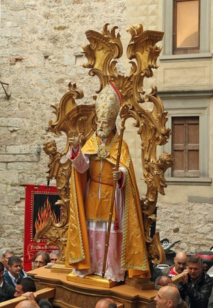 patron of europe: GUBBIO, ITALY - MAY 16: Sant Ubaldo figure St. Ubald, protector of masons carrying during the feast of the patron Saint Ubald of Gubbio, Umbria, Italy, Europe on May 16, 2015. Editorial