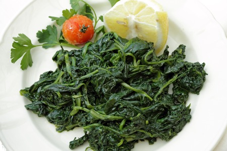 side dish: boiled spinach as side dish Stock Photo